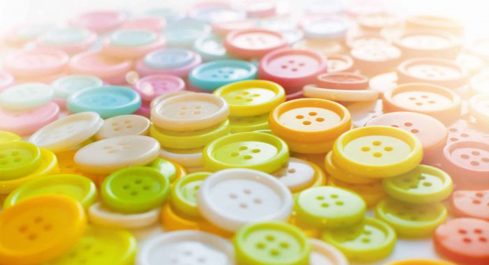 Many Colorful Sewing buttons. Bright background