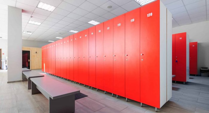 Interior of gym locker room, red, grey and white colored