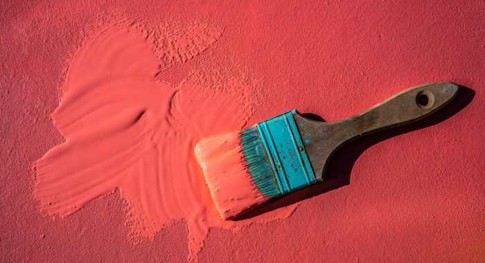 Coral color grunge brush with paint in monochromatic coral background wall