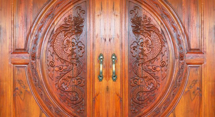 Dragon carved pattern on the wooden texture of door