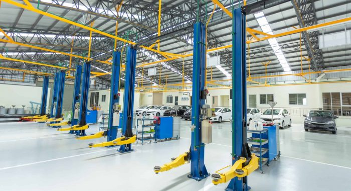 The electric lift for cars, interior car-care center. cars in the service put on the epoxy floor, Car service center.