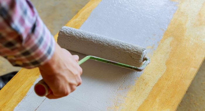 painting the wood with white paint roller House painting,paint roller