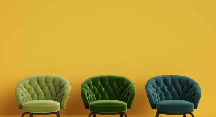 3 Classic tufted chairs in different green colors on yellow background with copy space.Digital Illustration.3d rendering