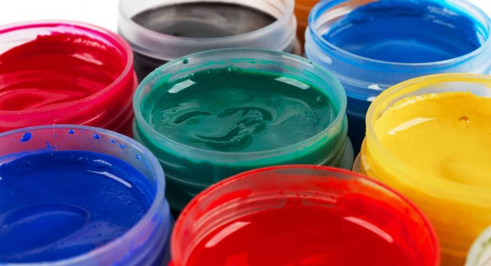Several jars with colored gouache, Closeup photo